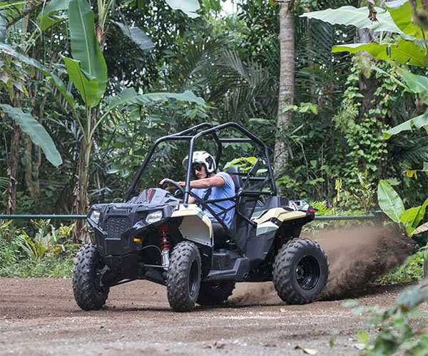 A man driving ATV in Bali jungle