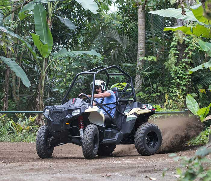 someone riding ATV in Bali jungle
