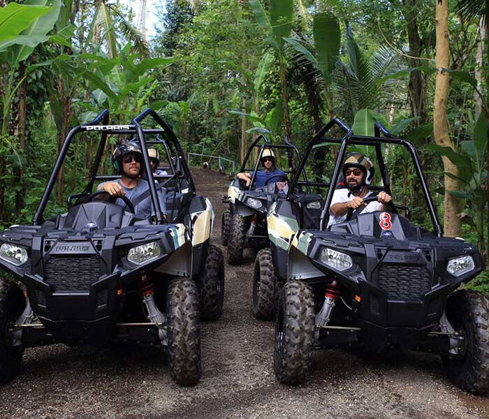 three people in ATV lining up for race in Bali jungle