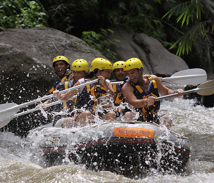 some people having fun with white water rafting in Bali