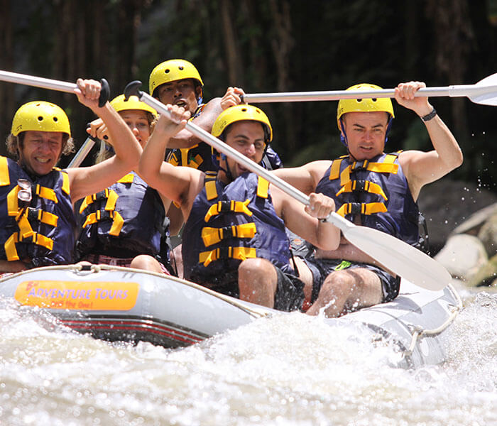 a team playing white water rafting in Ubud